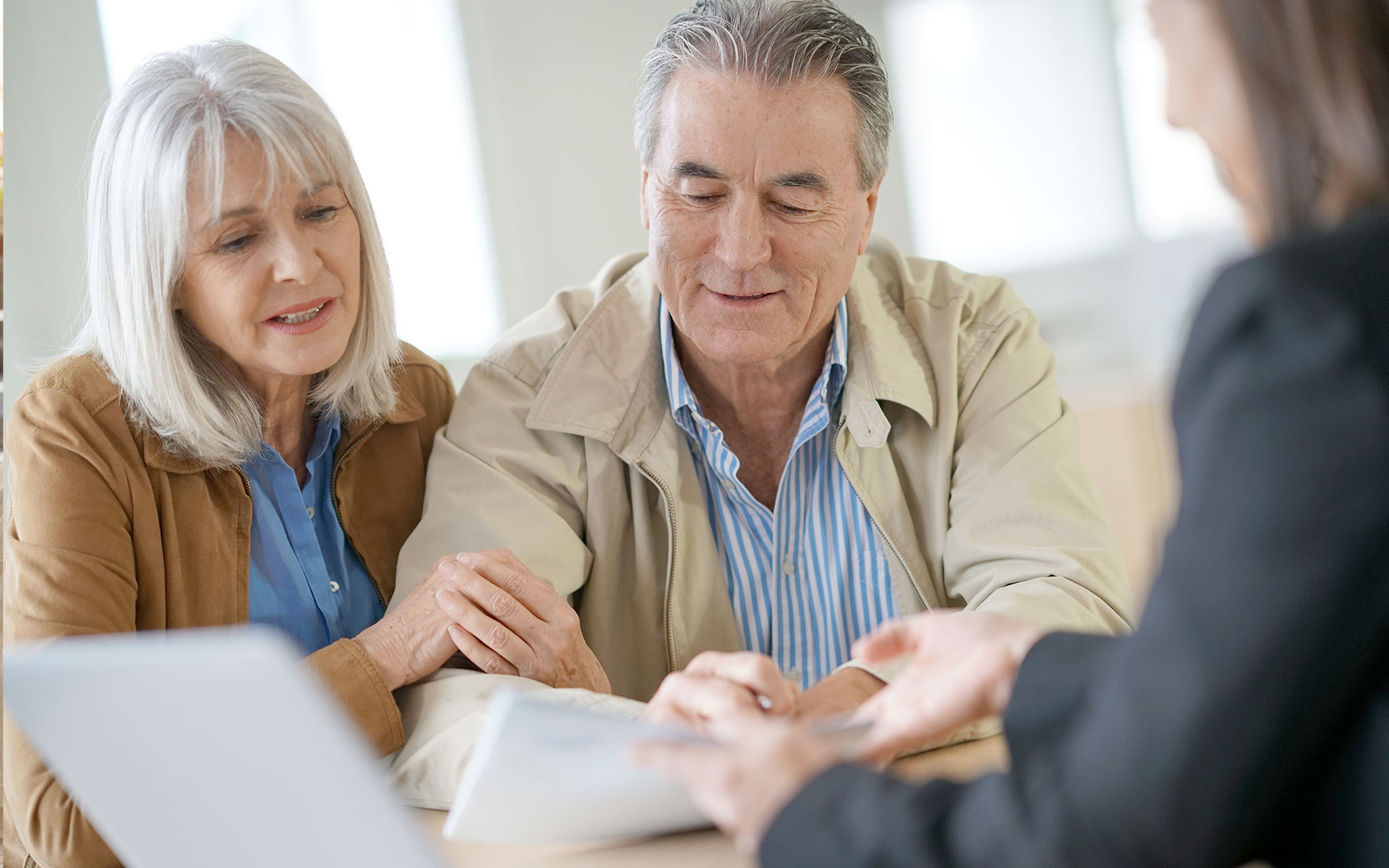 Older couple discussing estate planing